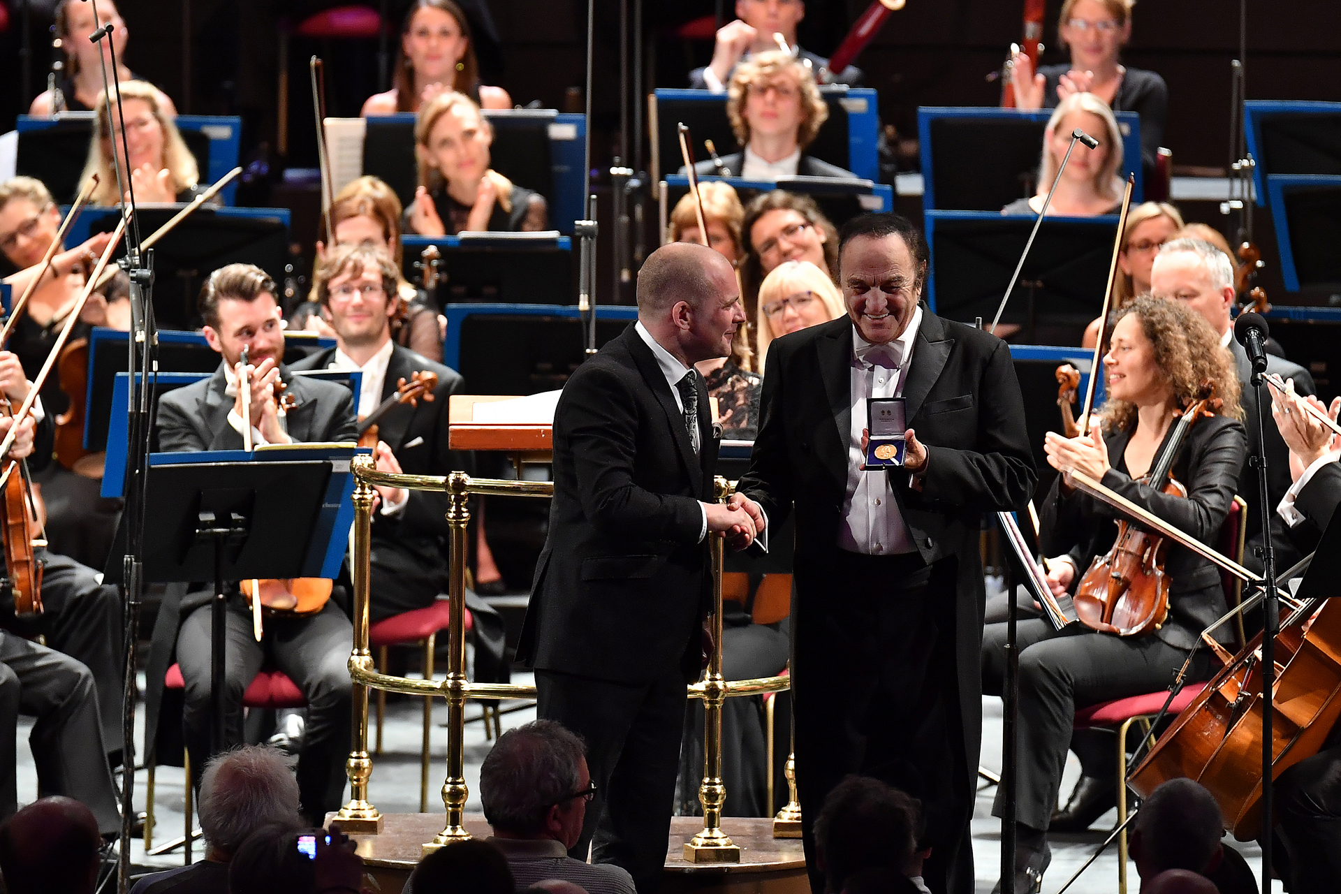 Conductor Charles Dutoit is presented with his Royal Philharmonic Society Gold Medal by John Gilhooly, RPS Chairman, during his BBC Proms concert with the Royal Philharmonic Orchestra on Thursday 17 August.  Featuring: Charles Dutoit, John Gilhooly Where: London, United Kingdom When: 17 Aug 2017 Credit: BBC/Chris Christodoulou/Supplied by WENN.com  **WENN does not claim any ownership including but not limited to Copyright, License in attached material. Fees charged by WENN are for WENN's services only, do not, nor are they intended to, convey to the user any ownership of Copyright, License in material. By publishing this material you expressly agree to indemnify, to hold WENN, its directors, shareholders, employees harmless from any loss, claims, damages, demands, expenses (including legal fees), any causes of action, allegation against WENN arising out of, connected in any way with publication of the material.**
