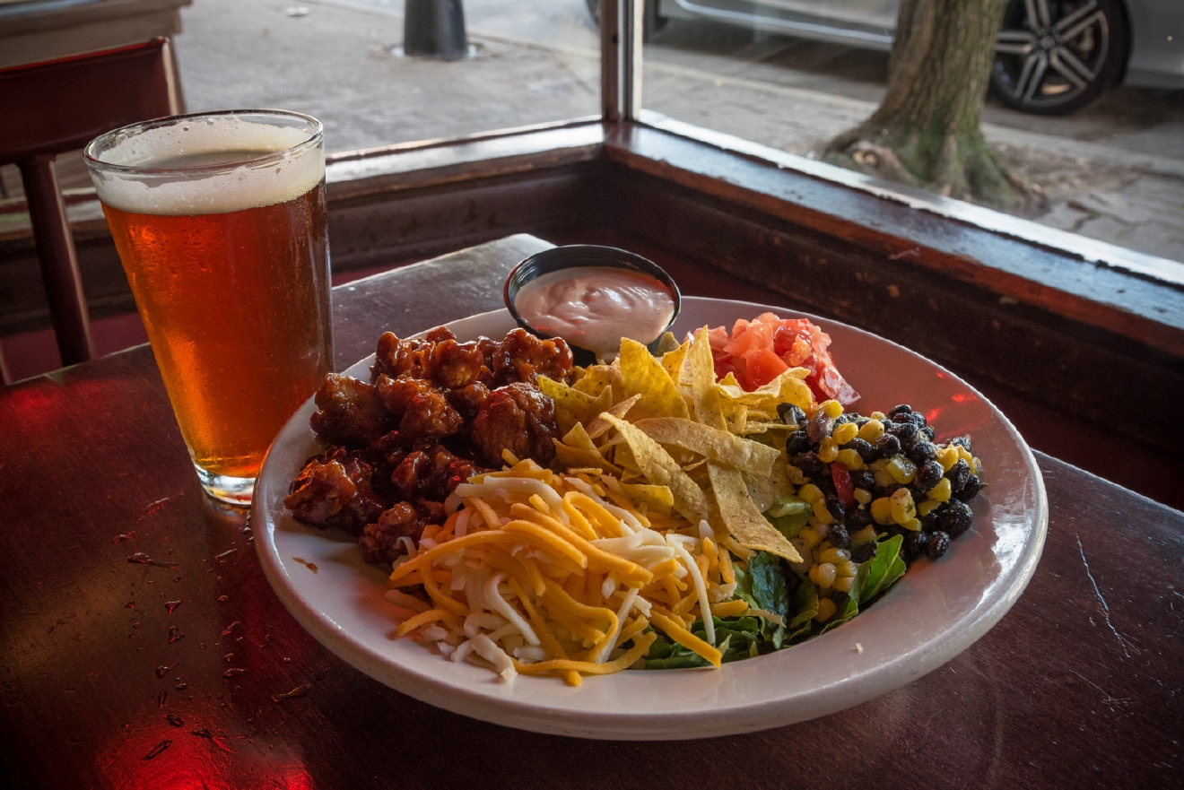 A pint of Mt. Carmel beer and a BBQ Chicken Salad: Sweet Baby Ray's BBQ sauce with black bean & corn salad, diced tomatoes, shredded cheese, and seasoned tortilla chips over chopped Romaine and served with BBQ ranch dressing. / Image: Phil Armstrong, Cincinnati Refined