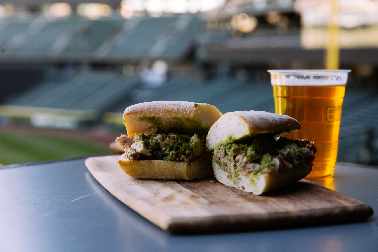 From Sultan of Sandwiches, Porchetta Sandwich, $12. Locally sourced pork rubbed with salt and fennel pollen and hand-rolled pork belly, finished with caper and basil pesto, served on a Franz Bakery ciabatta roll. Found in Section 105. (Image: Joshua Lewis/Seattle Refined).