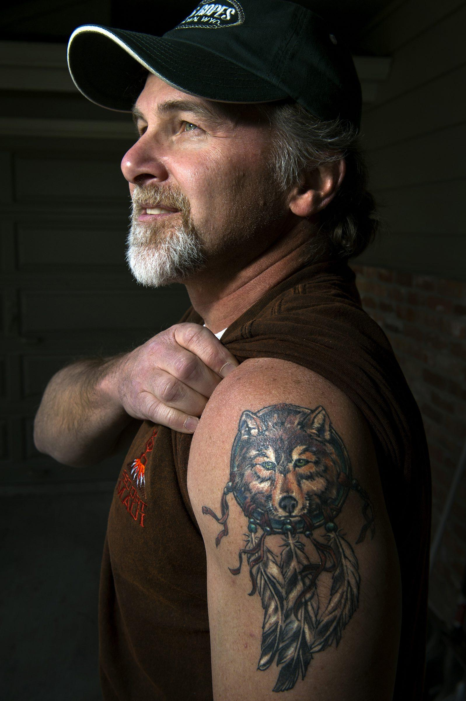 Steve Gilbertson's fascination with hiking and trail cameras led him to discover a new wolf pack in Washington, officially declared one of the state's 13 packs in March 2014. Gilbertson got to name the pack, and celebrated the occasion by having artwork of a wolf tattooed on his arm. COLIN MULVANY colinm@spokesman.com