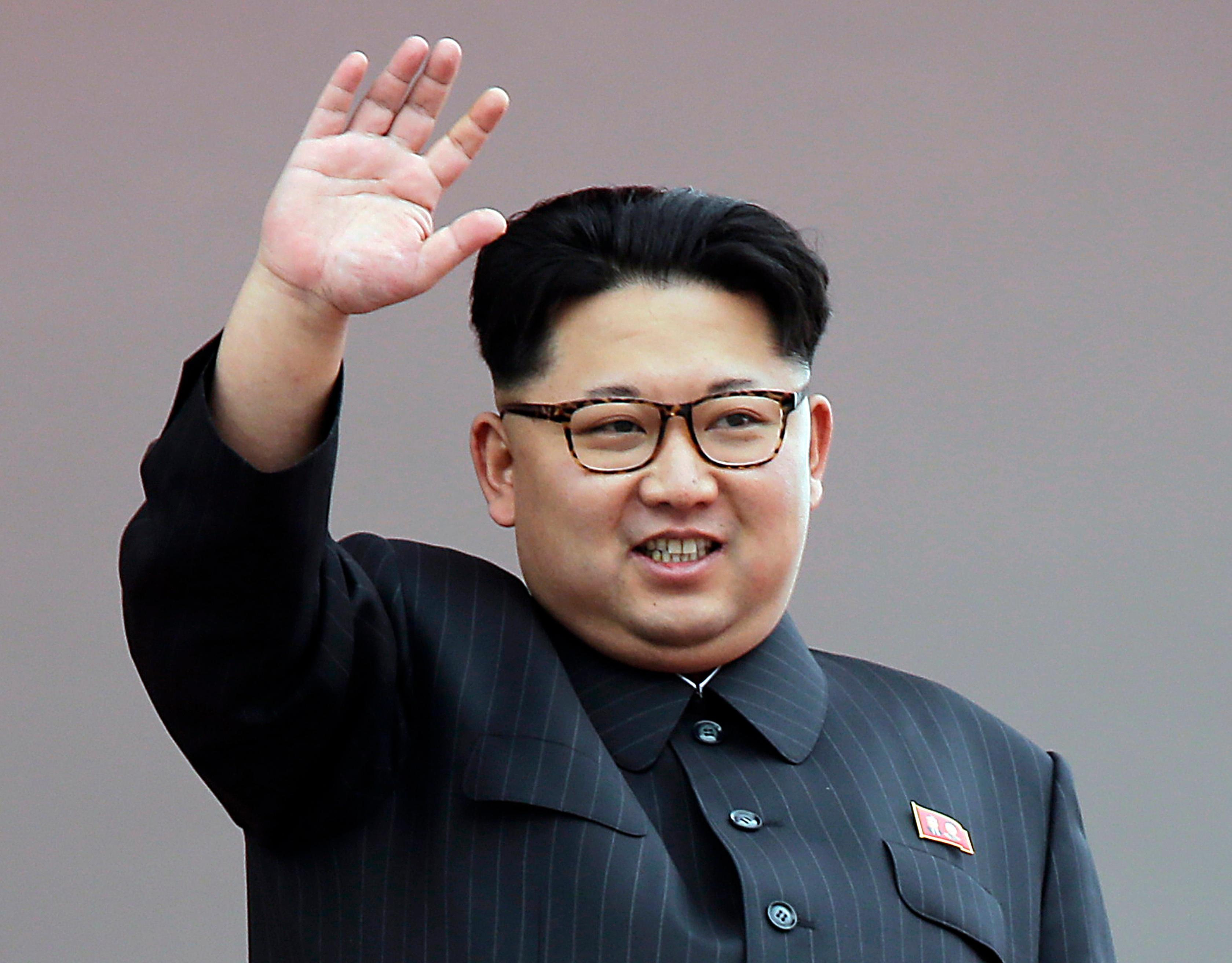 FILE - In this May 10, 2016, file photo, North Korean leader Kim Jong Un waves at parade participants at the Kim Il Sung Square in Pyongyang, North Korea. When Kim Jong Un took the helm of North Korea in late 2011, speculation swirled around the young leader. What would he do for an economically backward authoritarian nation in a high-stakes nuclear standoff with its neighbors and Washington? Almost six years later, his rule has actually seen the economy improve, and when it comes to the nuclear drive, it's obvious that Kim Jong Un, who rattled nerves last week by test-firing his country's first intercontinental ballistic missile, has a more uncompromising stance than his late father, Kim Jong Il.  (AP Photo/Wong Maye-E, File)