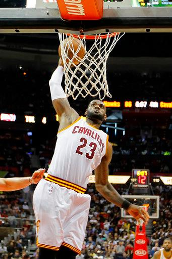 Cleveland Cavaliers forward LeBron James (23) goes up for the shot in the second half of an NBA basketball game against the Atlanta Hawks on Sunday, April 9, 2017, in Atlanta. The Hawks won in overtime 126-125. (AP Photo/Todd Kirkland)