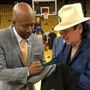 LOOK: Musician Santana gets Kenny Smith to sign his Spurs gear at Game 2